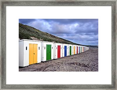 Row Of Colorful Beach Huts  Framed Print by Matthew Gibson
