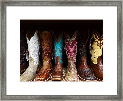 Row Of Cowboy Boots On Shelf Framed Print by Maggie Holguin / Eyeem