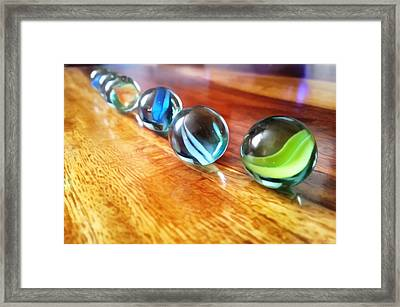 Row Of Marbles Framed Print