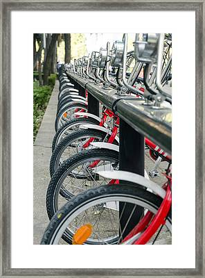 Row Of Public Bicycles Framed Print by Jess Kraft