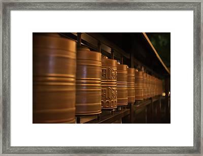 Row Of Spinning Prayer Wheels At Night Framed Print