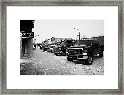 row of trucks and cars parked on the main street Biggar Saskatchewan Canada Framed Print