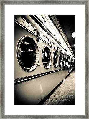 Row Of Washing Machines In Laundromat Framed Print by Amy Cicconi