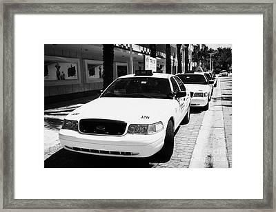 Row Of Yellow Cab Taxis In Miami South Beach Florida Usa Framed Print by Joe Fox
