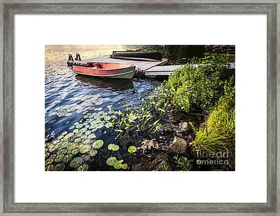 Rowboat At Lake Shore At Dusk Framed Print by Elena Elisseeva