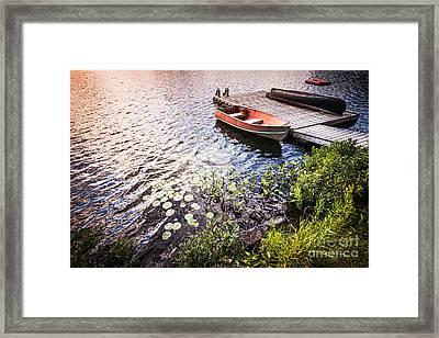 Rowboat At Lake Shore At Sunrise Framed Print by Elena Elisseeva