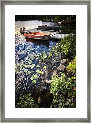 Rowboat At Lake Shore Framed Print by Elena Elisseeva