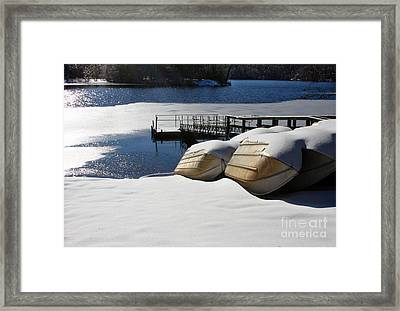 Rowboats Resting In Winter Framed Print