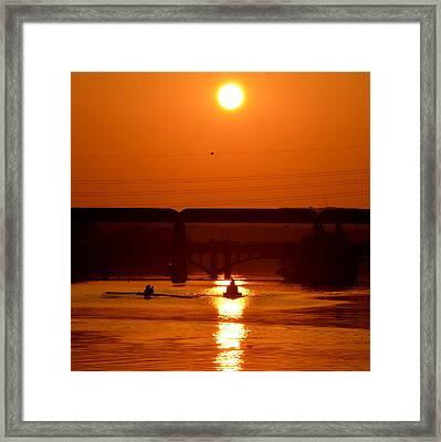Rowing Into The Sun Framed Print by Bindu Viswanathan