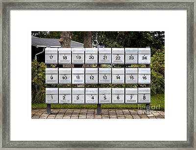 Rows Of Grey Mailboxes With Numbers Framed Print by Frank Bach