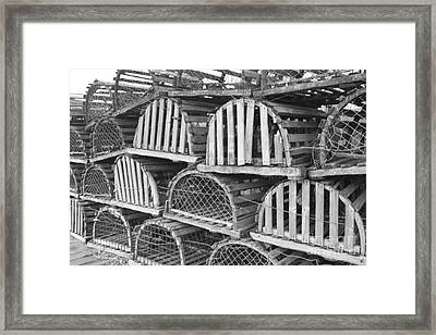 Rows Of Old And Abandoned Lobster Traps Framed Print by John Telfer