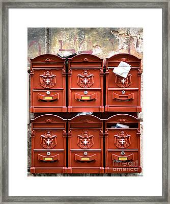Rows Of Red Mailboxes On A Rugged Wall Framed Print by Frank Bach