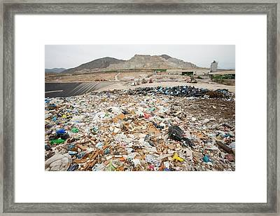Rubbish On A Landfill Site Framed Print by Ashley Cooper