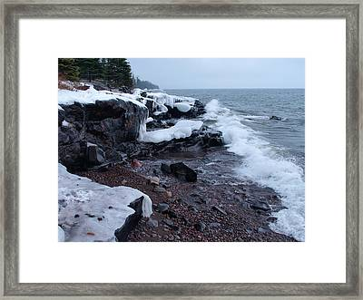 Rugged Shore Winter Framed Print by James Peterson