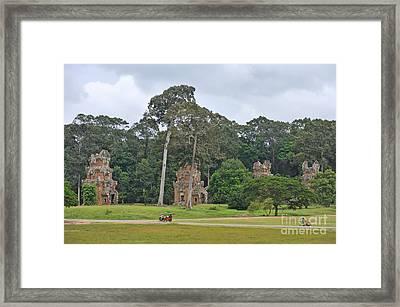 Ruins And Tourists At Angkor Wat Framed Print by Sami Sarkis