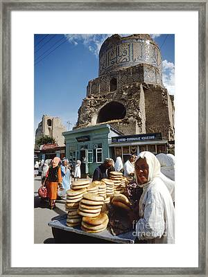 Ruins Of A Mosque With An Open Air Market Framed Print