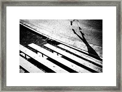 Runner's Shadow Framed Print by Caitlyn  Grasso