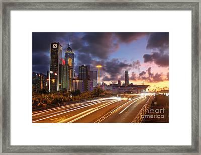 Rush Hour During Sunset In Hong Kong Framed Print by Lars Ruecker