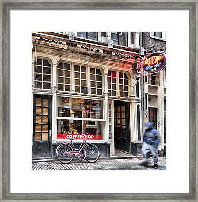 Rushing Past The Amsterdam Kafe Framed Print by Mick Flynn