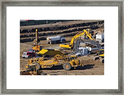 Rushing To Beat The Rain On A Commercial Construction Site Framed Print by Scott Lenhart