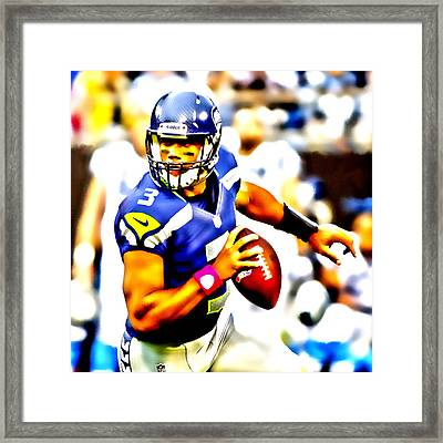 Russell Wilson In The Pocket Framed Print by Brian Reaves