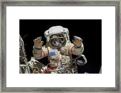 Russian Cosmonaut During A Spacewalk Framed Print