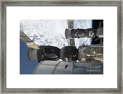 Russian Spacecraft Docked Framed Print by Stocktrek Images