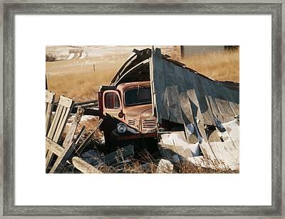 Rust Under The Fallen Barn In Navaho Montana Framed Print by Jeff Swan