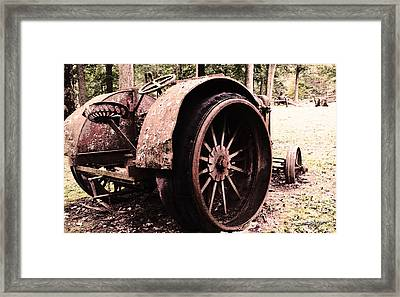 Rusted Big Wheels Framed Print
