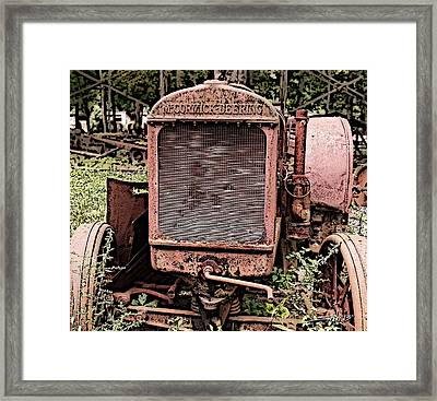 Rusted Mc Cormick-deering Tractor Framed Print by Michael Spano
