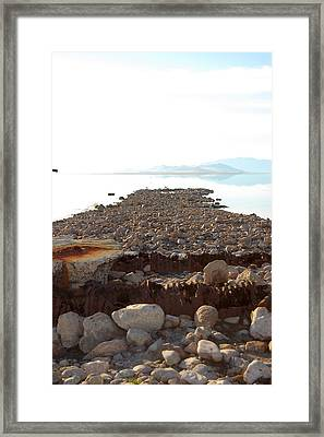 Rusted Pipe Thru Rock Path Framed Print by Holly Blunkall