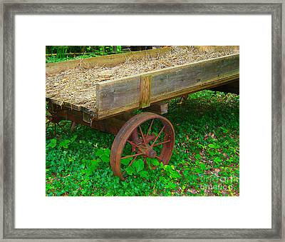 Rusted Wagon Wheel Framed Print by Val Miller