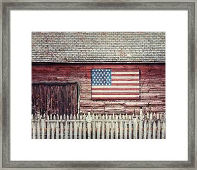 Rustic Red Barn With American Flag  Framed Print by Lisa Russo