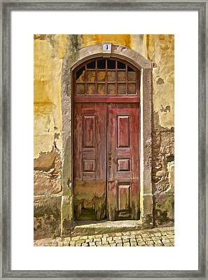 Rustic Red Wood Door Of The Medieval Village Of Pombal Framed Print by David Letts