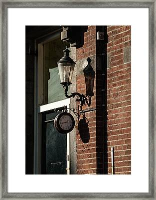 Rustic Wall Clock Against Facade Framed Print