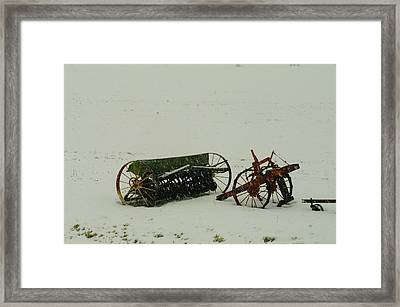 Rusting In The Snow Framed Print by Jeff Swan