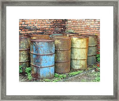 Rusting Oil Barrels Framed Print by Yali Shi