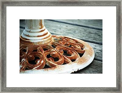 Rusting On The Deck Framed Print