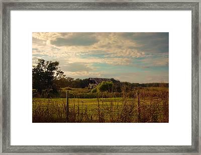 Rusty Barn At Sunset Framed Print by Jai Johnson