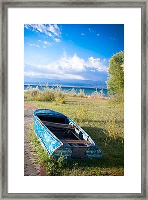 Rusty Blue Boat Framed Print by Sofia Walker