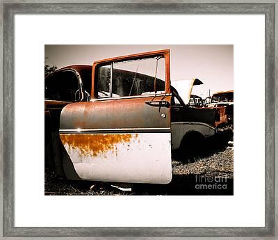 Rusty Car Doors Framed Print by Sonja Quintero