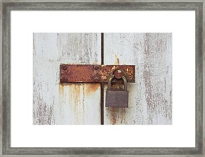 Rusty Lock Framed Print by Tom Gowanlock