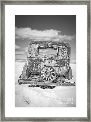 Rusty Old Car In The Snow Framed Print