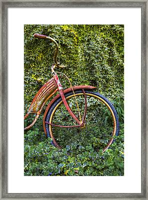 Rusty Wheel Framed Print by Debra and Dave Vanderlaan