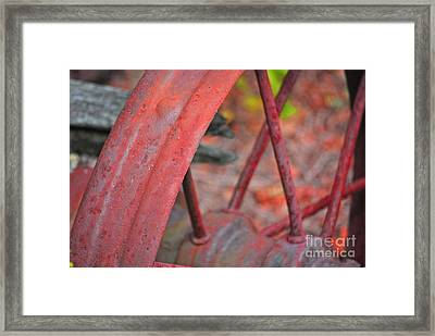 Rusty Wheel Framed Print by Jim Rossol