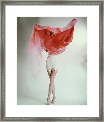 Ruth Knowles Lifting A Slip Dress To Reveal Framed Print by Erwin Blumenfeld