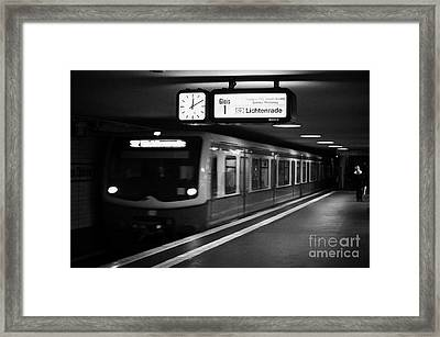 s-bahn train speeding through unter den linden underground station Berlin Germany Framed Print by Joe Fox