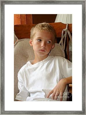 Sad Boy In Rocker Framed Print