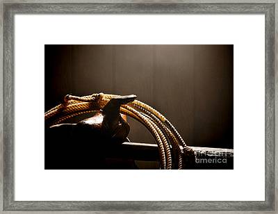 Saddle In A Barn Framed Print by Olivier Le Queinec