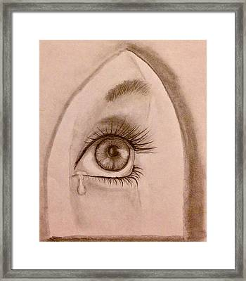Sadness In The Eye Framed Print
